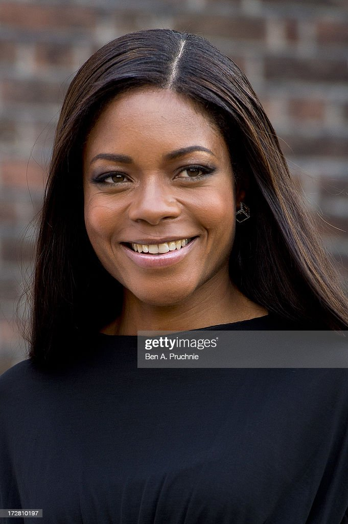 Naomie Harris attends the launch party for the Fashion Rules exhibition, a collection of dresses worn by HRH Queen Elizabeth II, Princess Margaret and Diana, Princess of Wales at Kensington Palace on July 4, 2013 in London, England.