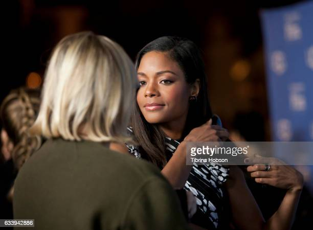 Naomie Harris fixes her hair before she walks the red carpet at the 32nd Santa Barbara International Film Festival Virtuosos Tribute at Arlington...