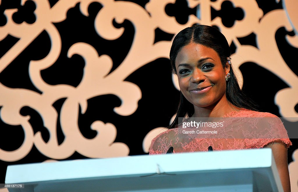<a gi-track='captionPersonalityLinkClicked' href=/galleries/search?phrase=Naomie+Harris&family=editorial&specificpeople=238918 ng-click='$event.stopPropagation()'>Naomie Harris</a> speaks on stage at the Oxfam Charity Gala on day six of the 10th Annual Dubai International Film Festival held at the Armani Hotel on December 11, 2013 in Dubai, United Arab Emirates.