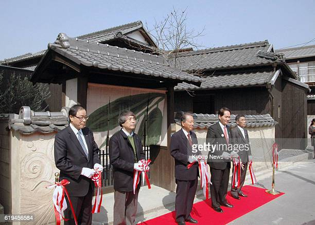 Naoshima Japan Architect Tadao Ando cuts the tape at the opening ceremony of Ando Museum a museum dedicated to his works on Naoshima an island in...