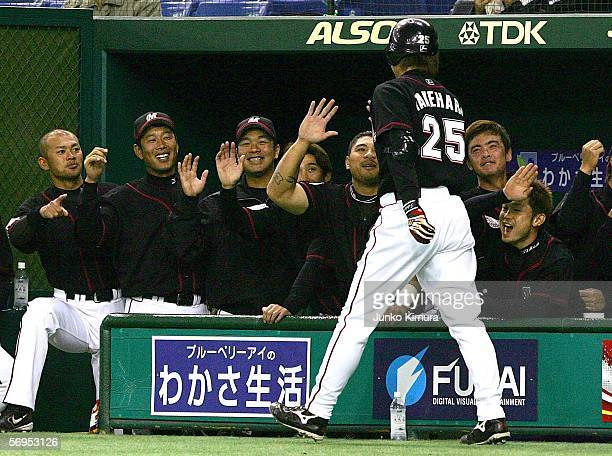 Naotaka Takehara of Chiba Lotte Marines celebrates his home run with his team mates during the 2006 World Baseball Classic Exhibition Game against...