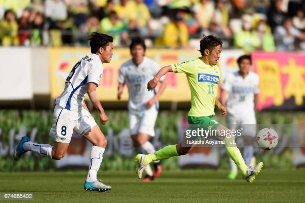 Naotake Hanyu of JEF United Chiba and Ken Iwao of Tokushima Vortis compete for the ball during the JLeague J2 match between JEF United Chiba and...