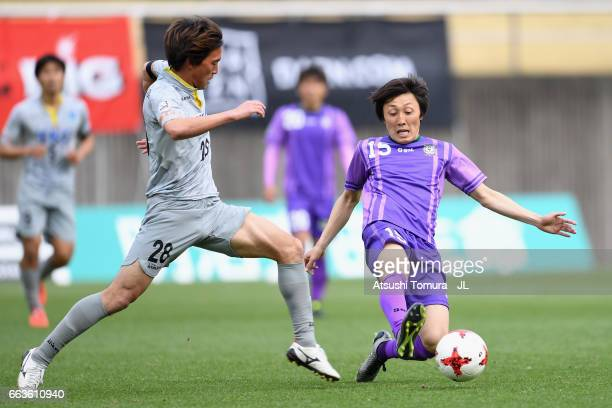 Naoto Ando of Tochigi SC and Taisuke Mizuno of Fujieda MYFC compete for the ball during the JLeague J3 match between Fujieda MYFC and Tochigi SC at...
