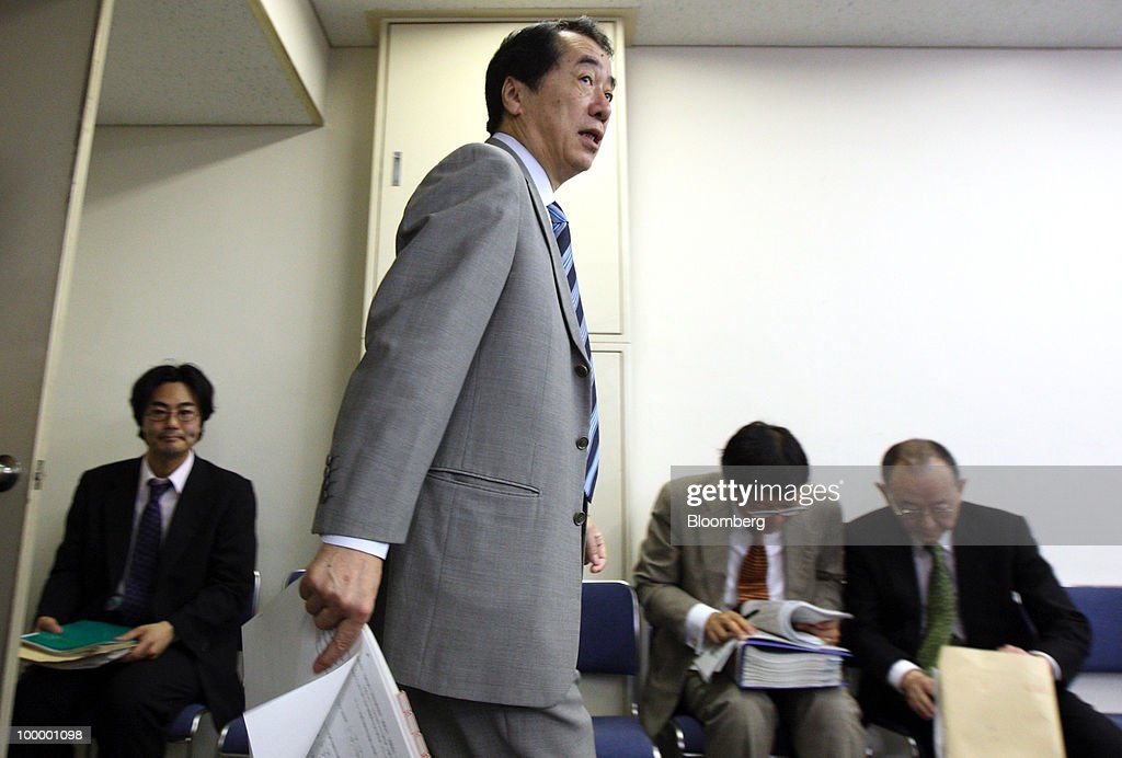 Naoto Kan, Japan's finance minister, arrives for a news conference in Tokyo, Japan, on Thursday, May 20, 2010. Japan's economy grew at the fastest pace in three quarters as an export surge prompted companies to increase capital spending even as the nation endures persistent deflation at home. Photographer: Tomohiro Ohsumi/Bloomberg via Getty Images