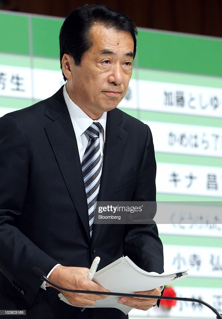 Naoto Kan, Japan's prime minister and president of the Democratic Party of Japan (DPJ), prepares to leave a news conference at the party's election center in Tokyo, Japan, on Monday, July 12, 2010. Kan lost control of parliament's upper house, undermining legislative efforts to cut the world's largest public debt and creating the possibility of a third leadership change in a year. Photographer: Haruyoshi Yamaguchi/Bloomberg via Getty Images