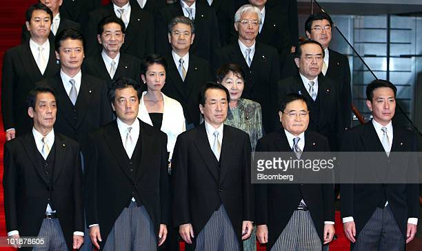 Naoto Kan Japan's prime minister center in the front row poses with his cabinet members from left to right in the front row Tatsuo Kawabata minister...