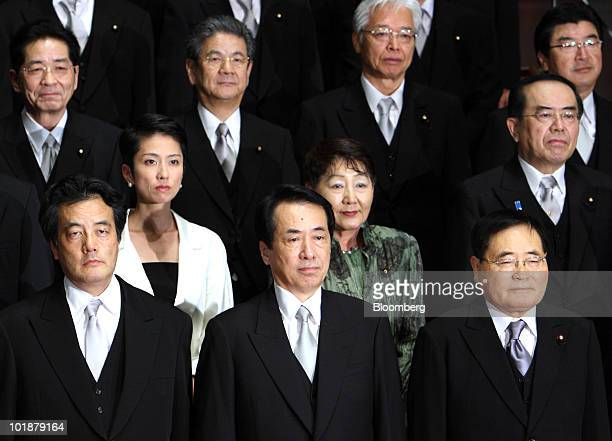 Naoto Kan Japan's prime minister center in the front row poses with his cabinet members from left to right in the front row Katsuya Okada foreign...