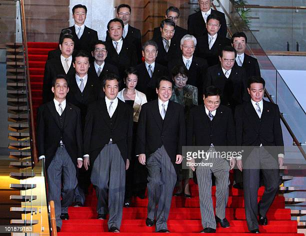 Naoto Kan Japan's prime minister center in the front row walks down the stairs to a photo session with his cabinet members including from left to...
