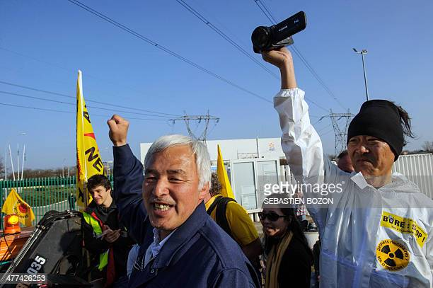 Naoto Mastumura nicknamed 'the last man of Fukushima' raises his fist in front of Fessenheim nuclear power plant during a demonstration to mark the...