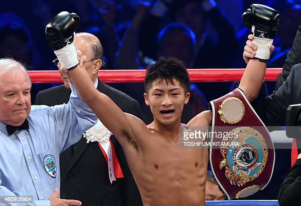 Naoya Inoue of Japan celebrates after beating Omar Andres Narvaez of Argentina to claim the World Boxing Organization super flyweight title in Tokyo...
