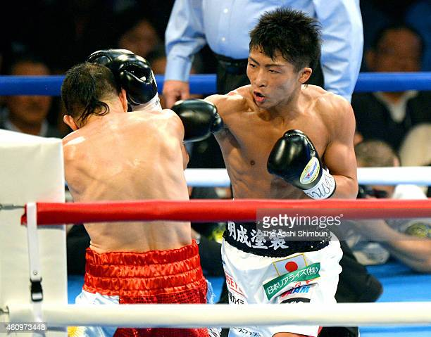 Naoya Inoue of Japan hits his right on Omar Andres Narvaez of Argentina during their WBO Super Flyweight Title bout at Tokyo Metropolitan Gymnasium...