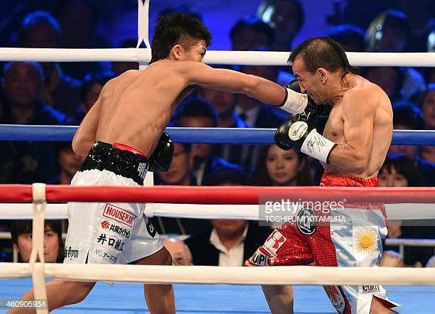 Naoya Inoue of Japan punches Omar Andres Narvaez of Argentina during their World Boxing Organization super flyweight title bout in Tokyo on December...
