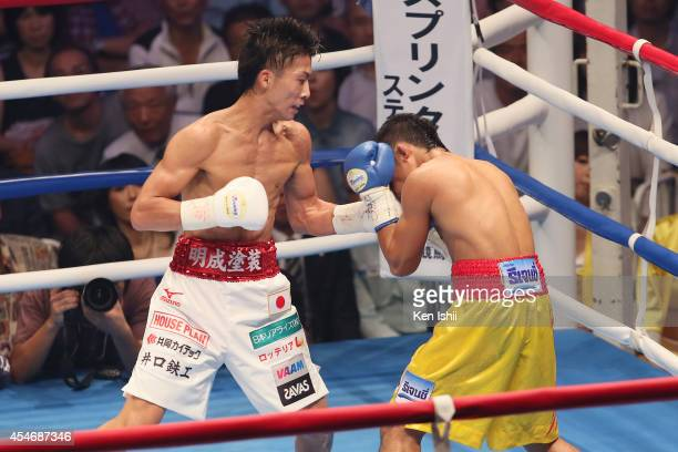 Naoya Inoue of Japan punches Samartlek Kokietgym of Thailand during the WBC light flyweight title bout between Naoya Inoue of Japan and Samartlek...