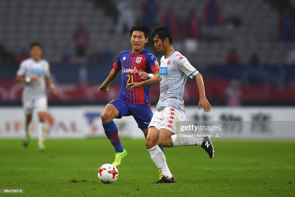 http://media.gettyimages.com/photos/naoya-kikuchi-of-consadole-sapporo-and-yu-insoo-of-fc-tokyo-compete-picture-id864226016