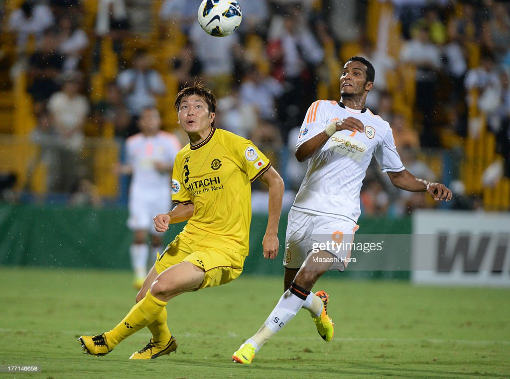 Naoya Kondo #3 of Kashiwa Reysol (L) and <a gi-track='captionPersonalityLinkClicked' href=/galleries/search?phrase=Naif+Hazazi&family=editorial&specificpeople=5779932 ng-click='$event.stopPropagation()'>Naif Hazazi</a> #9 of Al Shabab compete for the ball during the AFC Champions League Quarter Final 1st Leg match between Kashiwa Reysol and Al Shabab at Hitachi Ksahiwa Soccer Stadium on August 21, 2013 in Kashiwa, Chiba, Japan.