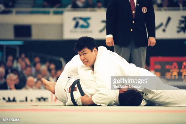 Naoya Ogawa holds Shinichi Shinohara to win by Ippon in the final during the All Japan Judo Championship at Nippon Budokan on April 29 1995 in Tokyo...
