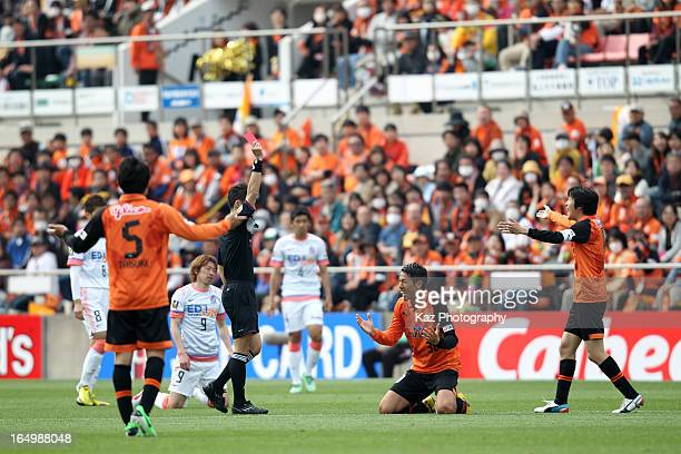 Naoya Okane of Shimizu SPulse is shown a red card by referee Jumpei Iida during the JLeague match between Shimizu SPulse and Sanfrecce Hiroshima at...