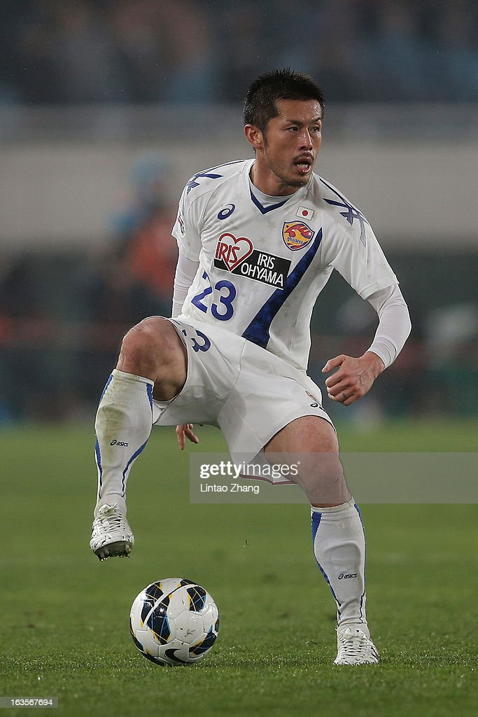 Naoya Tamura of Vegalta Sendaion controls the ball during the AFC Champions League match between Jiangsu Sainty and Vegalta Sendai at Nanjing Olympic Sports Center Stadium on March 12, 2013 in Nanjing, China.