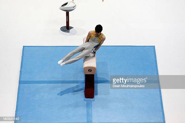 Naoya Tsukahara of Australia competes in the Pommel Horse on Day One of the Artistic Gymnastics World Championships Belgium 2013 held at the Antwerp...