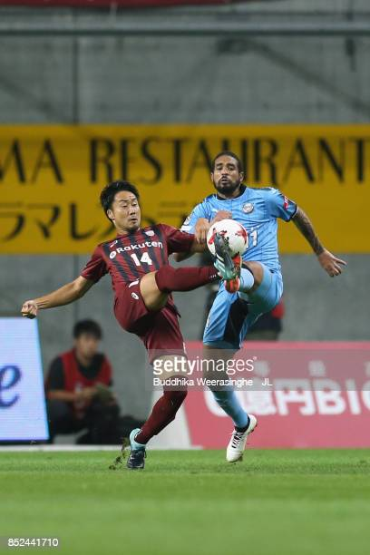 Naoyuki Fujita of Vissel Kobe and Eduardo Neto of Kawasaki Frontale compete for the ball during the JLeague J1 match between Vissel Kobe and Kawasaki...