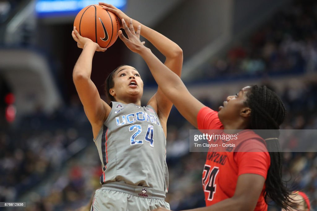 Napheesa Collier #24 of the Connecticut Huskies shoots while defended by Brianna Fraser #34 of the Maryland Terrapins during the the UConn Huskies Vs Maryland Terrapins, NCAA Women's Basketball game at the XL Center, Hartford, Connecticut. November 19th, 2017