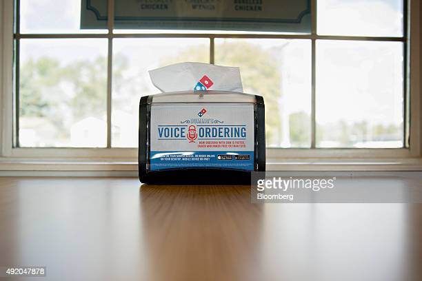 A napkin dispenser advertises online ordering options in the dining room of a Domino's Pizza Inc restaurant in Rantoul Illinois US on Thursday Oct 8...