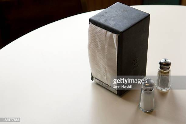 Napkin dispenser with salt and pepper shakers