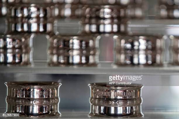A napkin ring with the name of French singer Johnny Hallyday is displayed among others at the newlyrenovated Barriere Le Fouquet's Hotel on the...
