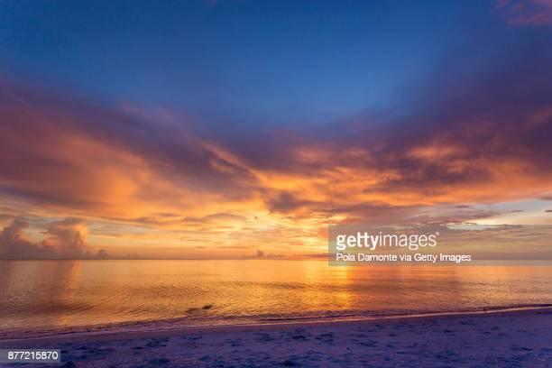 Naples beach amazing sunset and calm ocean, Florida, USA