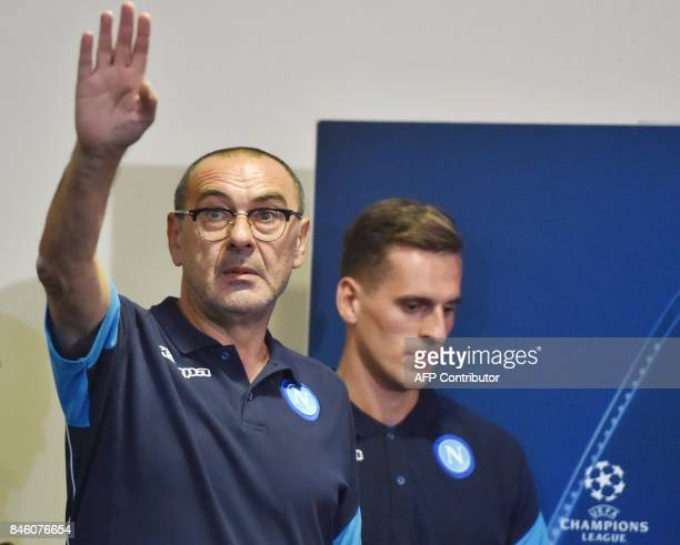 SSC Naples' head coach Maurizio Sarri reacts as SSC Naples' Polish forward Arkadiusz Milik looks on during a press conference at Metalist stadium in...