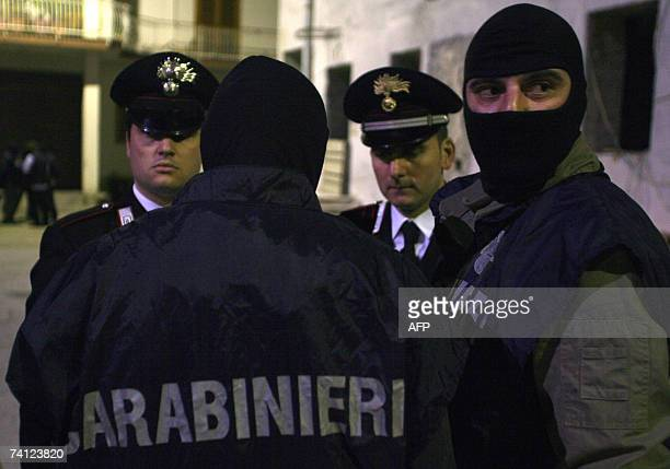 Italian Carabinieri of the ROS have a briefing before the entry in to a house of the Russo framily belonging to the Camorra gang in S Paolo Belsito...