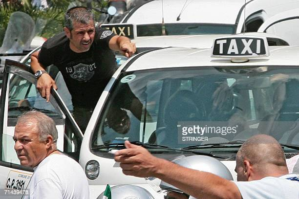 Taxi drivers are on strike 14 July 2006 in Piazza del Plebiscito in Naples in protest at government legislation to liberalise the trade and grant...
