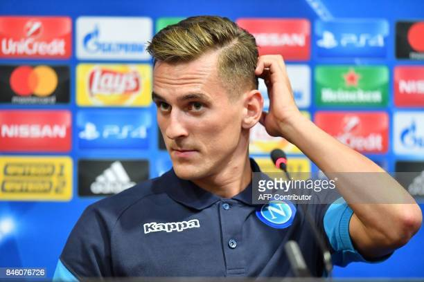 SSC Naples' Polish forward Arkadiusz Milik looks on during a press conference at the Metalist stadium in Kharkiv on September 12 on the eve of the...