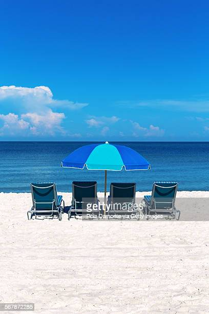Naples pristine beach, umbrellas and beach chairs