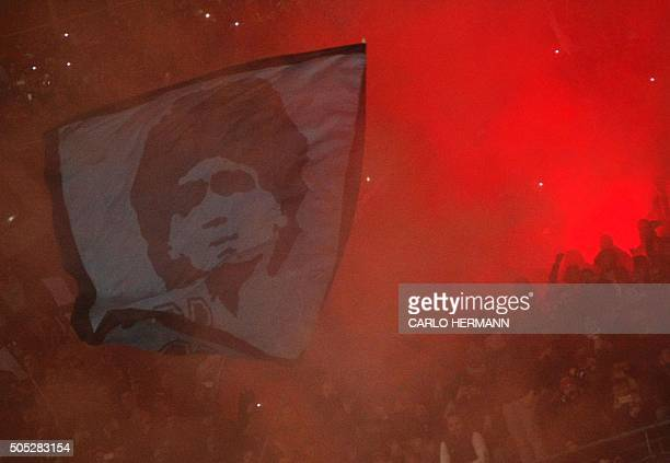 Napli's fans hold a giant flag depicting Naploi's former Argentinian player Diego Armando Maradona during the Italian Serie A football match between...