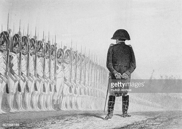 Napoleon Bonaparte as Emperor Napoleon 1 of France reviewing the Grenadiers of the Imperial Guard on 1 June 1811 in Paris France An engraving by...