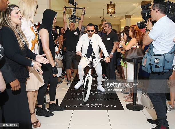 Napoleon Perdis rises a BMX bike into the David Jones Elizabeth Street Store on March 5 2015 in Sydney Australia