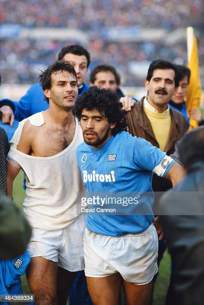 Napoli captain Diego Maradona leaves the field with Juventus player Antonio Cabrini after the Serie A match between the sides on March 9 1986 in...
