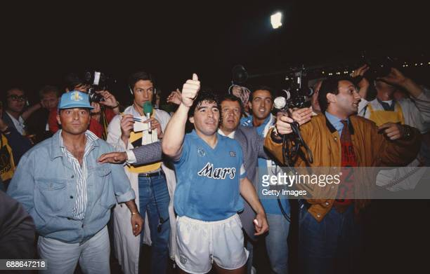 Napoli captain Diego Maradona surrounded by media after the 1989 UEFA Cup Final second leg between VFB Stuttgart and SSC Napoli at Neckarstadion on...