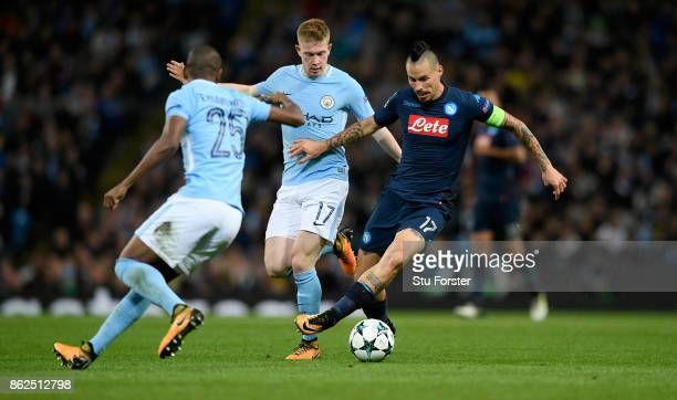 Napoli captain Marek Hamsik is challenged by Kevin de Bruyne during the UEFA Champions League group F match between Manchester City and SSC Napoli at...