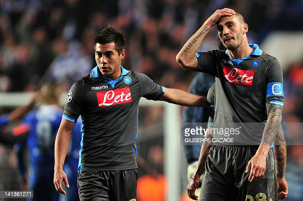 Napoli defender Paolo Cannavaro and forward Eduardo Vergas react on March 14 2012 at the end of a Champions League round of 16 second leg football...