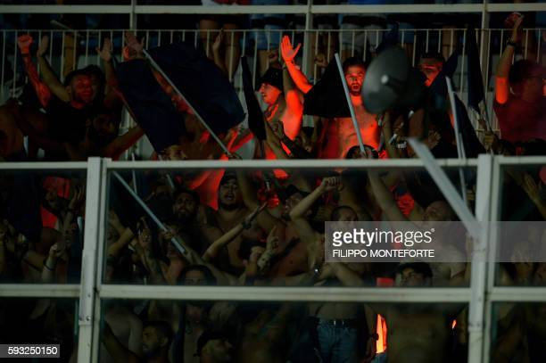 Napoli fans cheer for their team during the italian Serie A football match Pescara vs Napoli at the Adriatico Stadium in Pescara on August 21 2016 /...