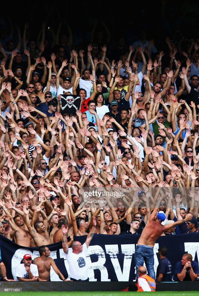 Napoli fans sing and chant during the Bobby Moore Cup between West Ham United and Napoli at Upton Park on August 8, 2009 in London, England.