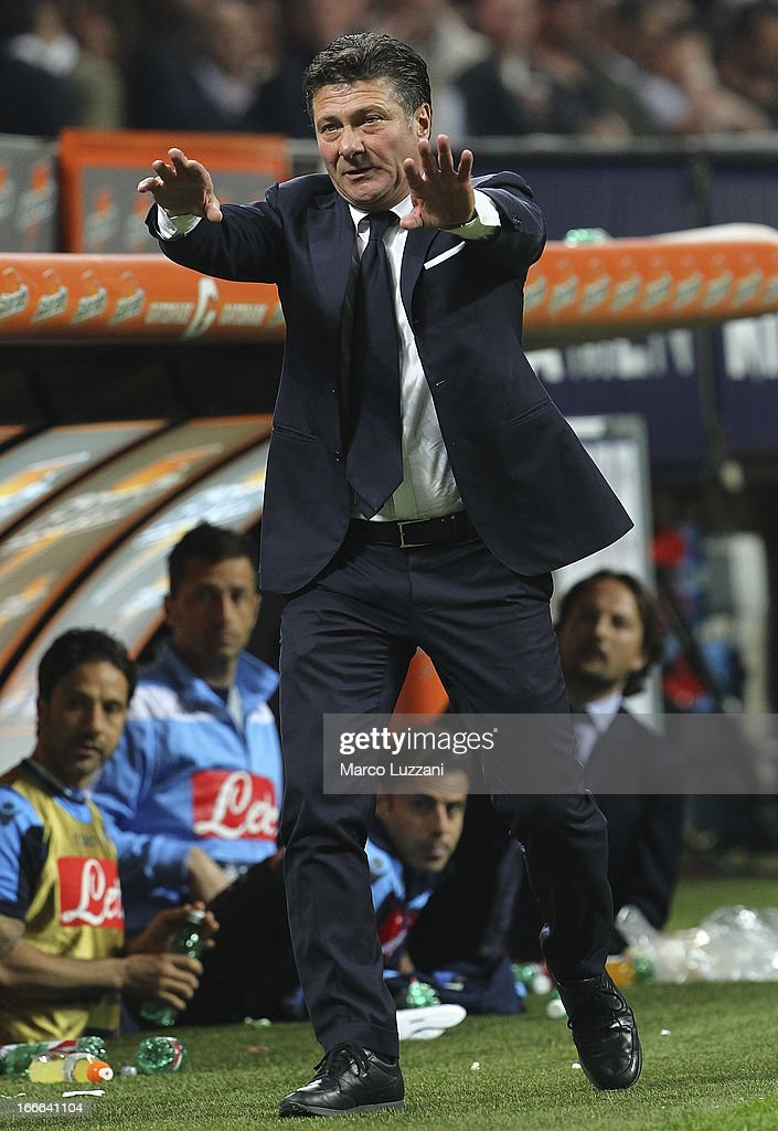 Napoli manager <a gi-track='captionPersonalityLinkClicked' href=/galleries/search?phrase=Walter+Mazzarri&family=editorial&specificpeople=5314636 ng-click='$event.stopPropagation()'>Walter Mazzarri</a> gestures during the Serie A match between AC Milan and SSC Napoli at San Siro Stadium on April 14, 2013 in Milan, Italy.