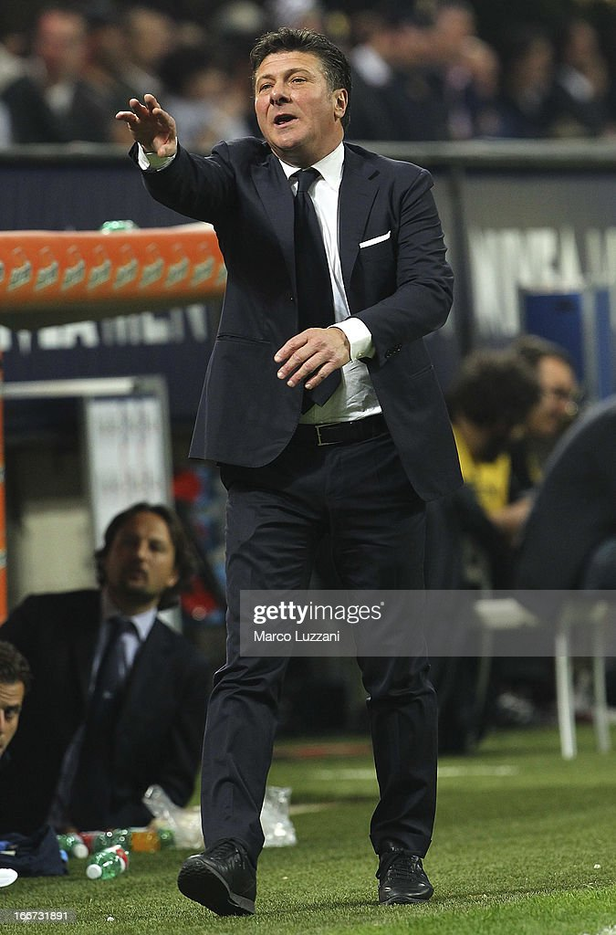 Napoli manager Walter Mazzarri gestures during the Serie A match between AC Milan and SSC Napoli at San Siro Stadium on April 14, 2013 in Milan, Italy.
