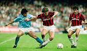 Napoli player Diego Maradona challenges Carlo Ancelotti of AC Milan during an Italian League match on October 21 1990 in Naples Italy