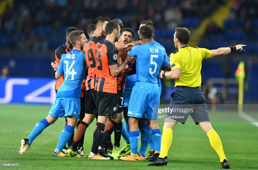 SSC Napoli players and FC Shakhtar players react during the UEFA Champions League Group F football match between FC Shakhtar Donetsk and SSC Napoli at The Metalist Stadium in Kharkiv on September 13, 2017. /