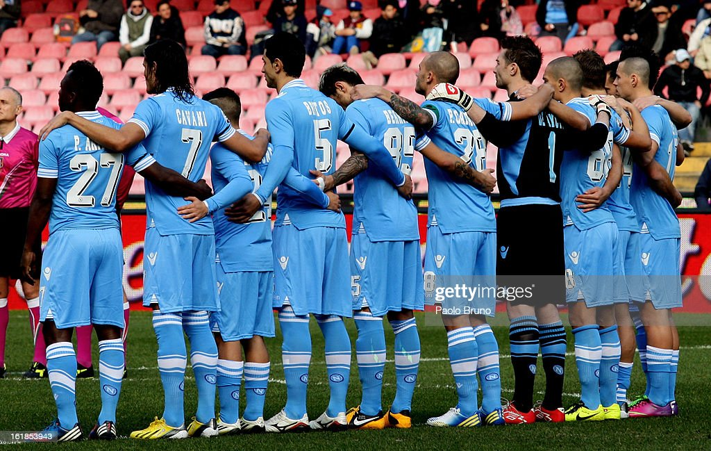 Napoli players stand together to observe a minute's silence in memory of former SSC Napoli player Carmelo Imbriani (February 10, 1976 - February 15, 2013) before the start of the Serie A match between SSC Napoli and UC Sampdoria at Stadio San Paolo on February 17, 2013 in Naples, Italy.