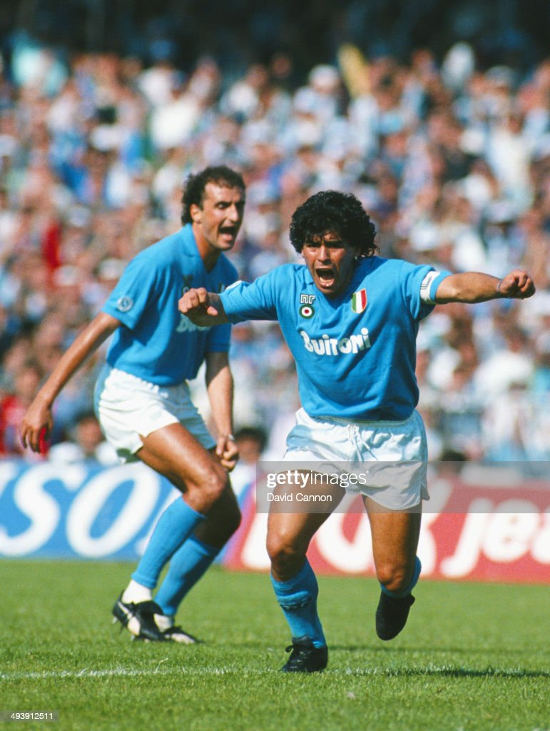 Napoli SSC player <a gi-track='captionPersonalityLinkClicked' href=/galleries/search?phrase=Diego+Maradona&family=editorial&specificpeople=210535 ng-click='$event.stopPropagation()'>Diego Maradona</a> (r) celebrates a goal during an Italian League match between Napoli SSC and AC Milan at San Paolo Stadium in Naples, Italy.