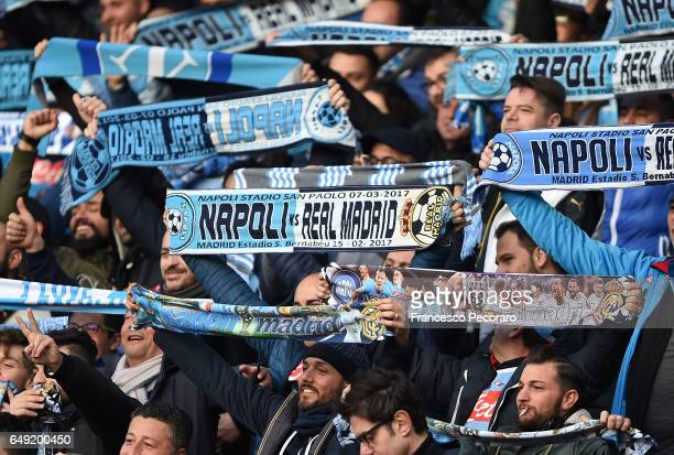 Napoli supporters cheer their team during the UEFA Champions League Round of 16 second leg match between SSC Napoli and Real Madrid CF at Stadio San...